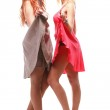 Two pretty women ginger with blonde in gowns on white — Stock Photo #8557379