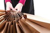 шоппинг коричневый подарочные сумки фон — Стоковое фото