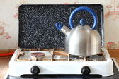 Kettle and gas cooker on kitchen — Stock Photo