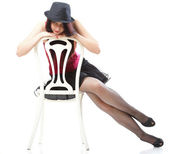 Showgirl woman dance in red corset chair white isolated — Stock Photo