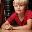 Boy child sitting on floor — Stock Photo #9471684