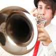 Portrait of a young man playing his Trumpet — Stock Photo