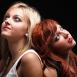 Two happy young girlfriends black background — Stock Photo #9915209
