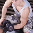 Stock Photo: Sitting and weightlifting