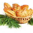 Stock Photo: Set of pies in a basket with pine boughs