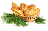 Set of pies in a basket with pine boughs — Stock Photo