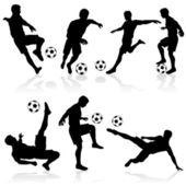 Siluetas de los jugadores de fútbol — Vector de stock