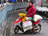 Chinese motorcyclist — Stock Photo