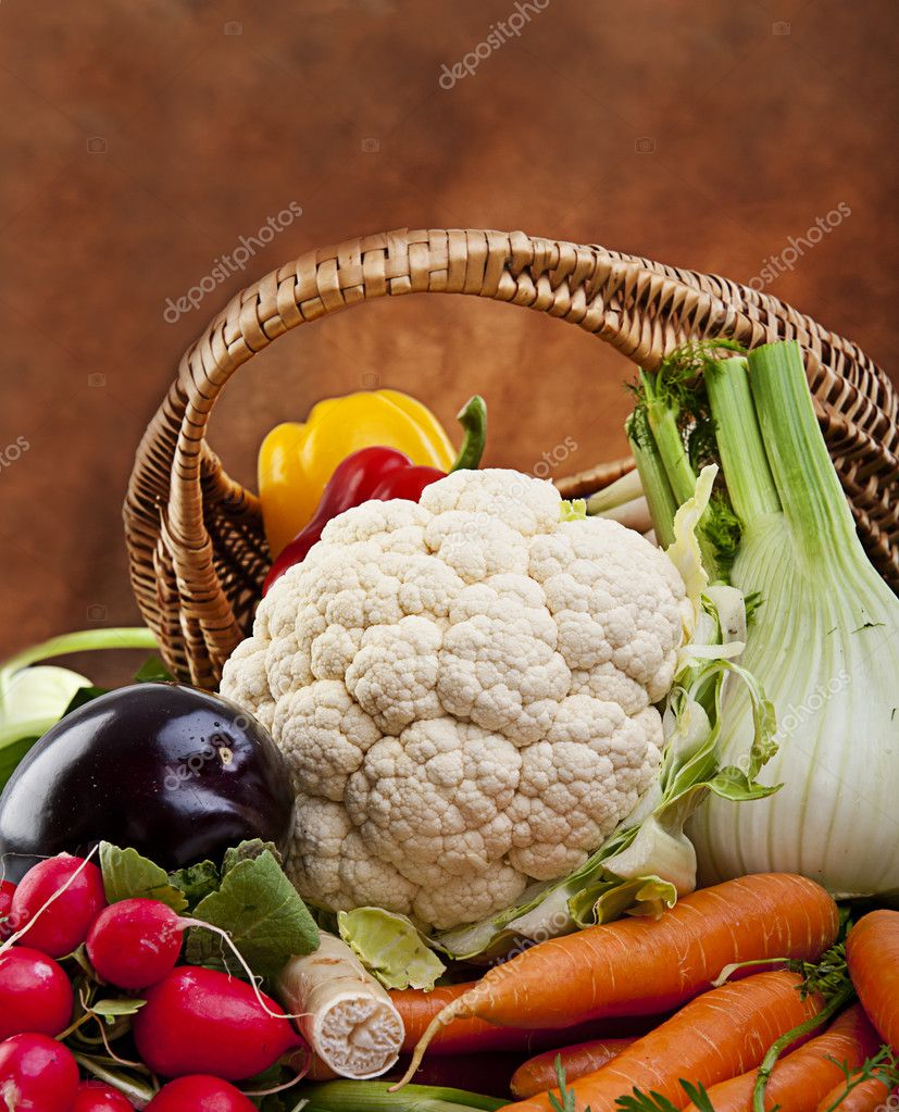 Basket full of various fresh organic vegetables from the garden — Stock Photo #10587459