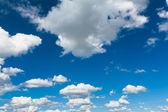 Blue sky with small clouds — Stock Photo