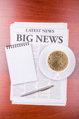 The newspaper BIG NEWS and coffee — Stock Photo