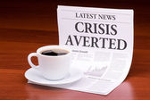 The newspaper LATEST NEWSwith the headline CRISIS AVERTED — Stock Photo
