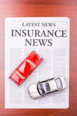 The newspaper INSURANCE NEWS and auto — Stock Photo