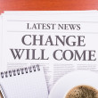 The newspaper CHANGE WILL COME and coffee — Stock Photo