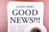 The newspaper GOOD NEWS and coffee — Stock Photo