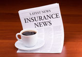 The newspaper LATEST NEWS with the headline INSURANCE NEWS — Stock Photo