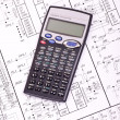 Stock Photo: Calculator on the drawing electrical circuit