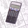 Calculator on the drawing electrical circuit — Stock Photo