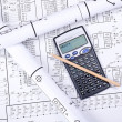 Stock Photo: Blueprint crosswise and calculator
