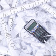Calculator and waste paper — Stock Photo