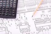 Calculator and pencil on drawing — Stockfoto