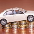 Model car on a pile of coins — Stock Photo #8353477
