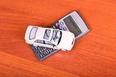 Model car on a calculator — Stock Photo