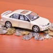 Model car on a placer of coins — Stock Photo #8623516