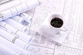 Cup of coffee and drawing — Stock Photo