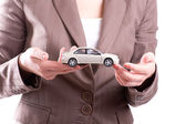 Hands and model of car — Stock Photo