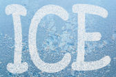 Frost pattern and word ICE — Stock Photo