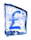 Sign pound sterling frozen in the ice — Stock Photo