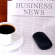 Business newspaper, cup of coffee and mouse - Stock Photo