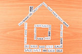 House made ​​of paper with the inscription SALE — Stock Photo