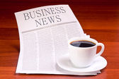 Newspaper and cup of coffee — Stock Photo