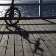 Bicycle at the pier - Stock Photo