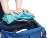 Woman hand crammed full of clothes and shoulder bag isolated — Stock Photo