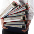Man holding stack of folders  - Isolated - Stock Photo
