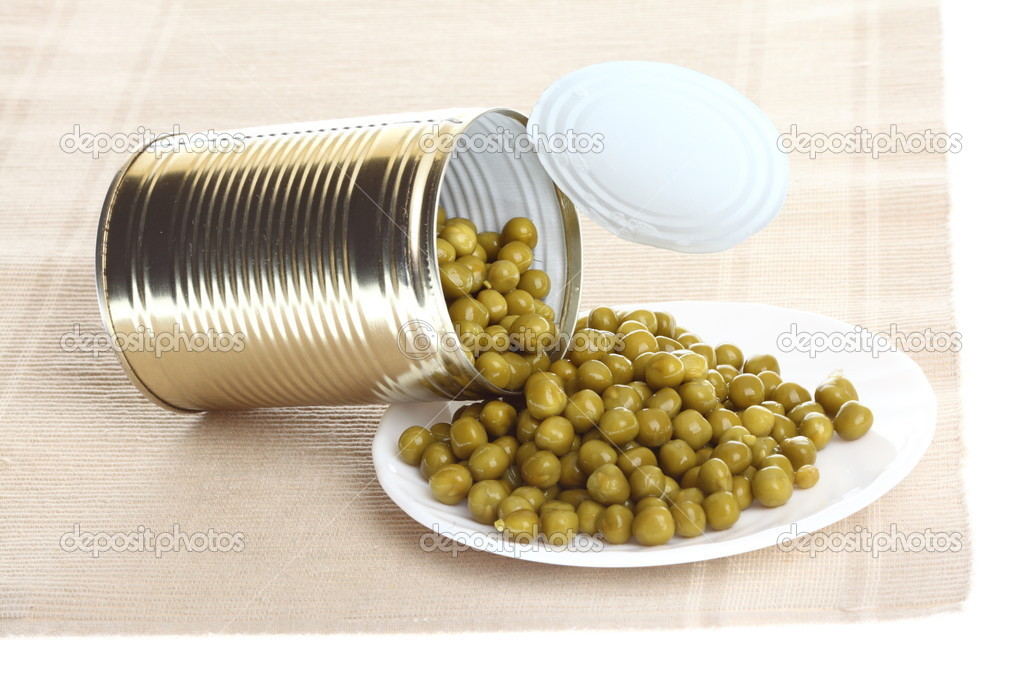 Tin opening a can of food canned, tinned peas  Stock Photo #9092280