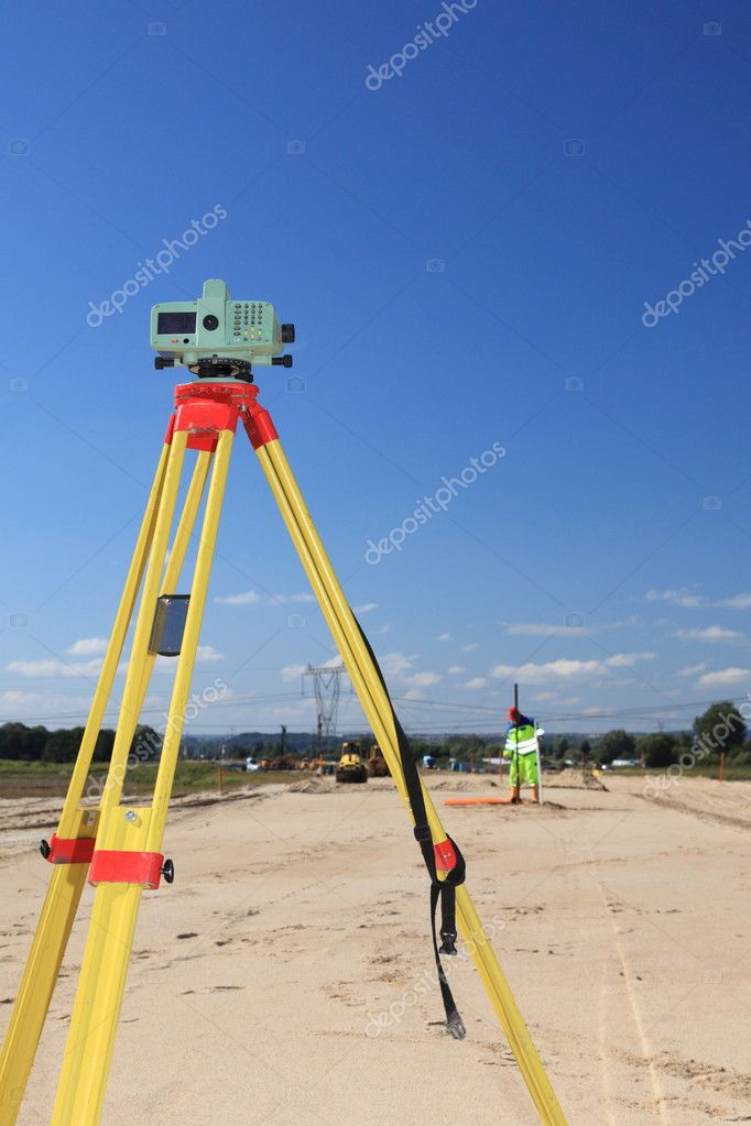 Builder's level - construction site by theodolite level transit equipment — Stock Photo #9168565