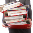 Woman holding stack of folders - Isolated — Stock Photo #9584484