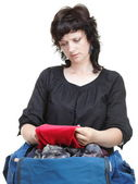 Woman crammed full of clothes and shoulder bag isolated — Stock Photo