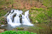 Waterfall in the forest in spring — Stock Photo