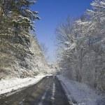Snowy mountain road — Stock Photo