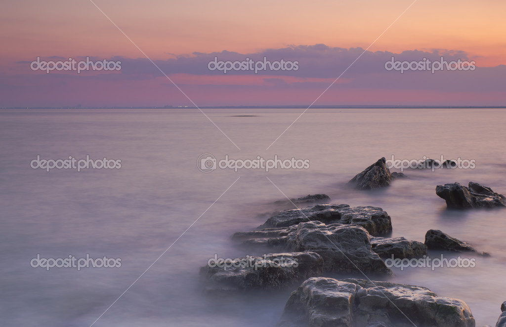 Beautiful sunset on rocky shore  Stock Photo #9122844