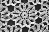 Floral crochet on black background — Stock Photo