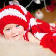 Cute little girl in the New Year bell — Stock Photo #10600357