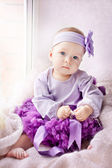 Cute little girl lies in skirt — Stock Photo