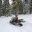 Man on a snowmobile — Stock Photo