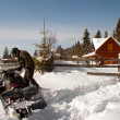 Foto Stock: Mwith snowmobile